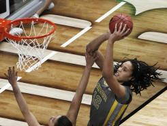 Baylor center Brittney Griner shoots over Notre Dame forward Natalie Achonwa (11) and Notre Dame guard Natalie Novosel (21). The Bears beat the Irish 80-61 in the national championship game.