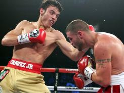 Julio Cesar Chavez Jr., left, has not lost in 46 career fights. Here, he defeated Peter Manfredo last November.