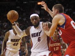 Heat forward LeBron James drives against the 76ers' Spencer Hawes during their Tuesday game. James had 41 points in the Miami win.