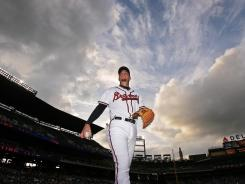 In this photo taken, May 18, 2008, Atlanta Braves third baseman Chipper Jones walks off the field before the Braves faced off against the Oakland Athletics. After batting practice Tuesday, Jones said his surgically repaired knee is giving him no problems.
