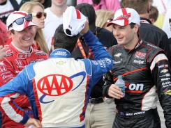 Race winner Will Power, right, talks with fellow drivers Helio Castroneves (facing away) and Scott Dixon afterward at Barber Motorsports Park. Power and Castroneves have won both races to start the season for Penske Racing and Chevrolet. Dixon has been second in both races.