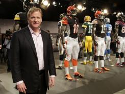 NFL Commissioner Roger Goodell, posing for a photo in front of Nike's new NFL uniforms in New York on Tuesday, might soon rule on possible suspensions for Saints players tied to the team's bounty system.