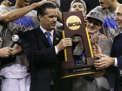 Kentucky coach John Calipari, center, celebrates with his team after the Wildcats beat Kansas.