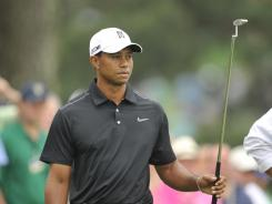 Tiger Woods, playing in the Masters for the 18th time as an amateur and pro, looks over the seventh green during a practice round Tuesday.