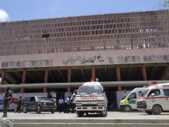 Ambulances stand outside the Somali National Theater in Mogadishu, Somalia on Wednesday. An explosion Wednesday at a ceremony at Somalia's national theater killed at least 10 people including two top sports officials in an attack by an Islamist group on a site that symbolized the city's attempt to rise from two decades of war.