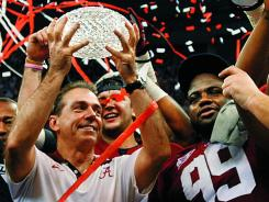 Coach Nick Saban and Alabama players celebrate in January after beating LSU in the Bowl Championship Series national title game. The BCS is discussing new formats to determine a champion.