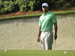 Tiger Woods works on his bunker shots on the 13th hole during a practice round Wednesday.
