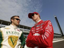IndyCar drivers Ed Carpenter, left, and Scott Dixon talk before practicing at Indianapolis Motor Speedway on Wednesday.