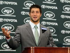 The New York Jets' Tim Tebow addresses the media as he is introduced to media on March 26, 2012.