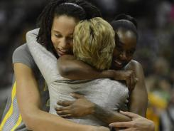 Coach Kim Mulkey says she and her players, such as star center Brittney Griner, left, and Jordan Madden, wrapped their arms around the expectations of greatness going into the season.
