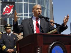 Newark Mayor Cory Booker talks during a news conference outside of the Prudential Center Wednesday.