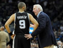 San Antonio Spurs coach Gregg Popovich is making sure his veteran star players, such as guard Tony Parker here, are well rested entering the playoffs, a strategy not universally shared.