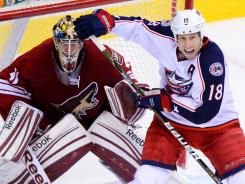 Coyotes goalie Mike Smith stays focused while Columbus winger R.J. Umberger screens him during Tuesday's 2-0 Phoenix win.