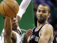 Boston guard Rajon Rondo, left, loses control of the ball against San Antonio guard Tony Parker during the first half of in Boston.