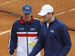 U.S. captain Jim Courier, left, and his top guy, John Isner, put in a training session Wednesday.