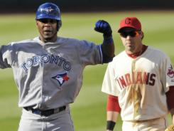 Toronto Blue Jays designated hitter Edwin Encarnacion (left) celebrates beside Cleveland Indians second baseman Jason Kipnis (22) after tying the game in the ninth inning.