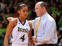 Fighting Irish associate head coach Jonathan Tsipis, right, coached Notre Dame All American Skylar Diggins (4) for the past three seasons.