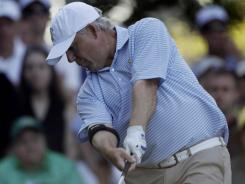Amateur Randal Lewis tees off on the fourth hole during the first round of the Masters.