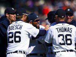 Tigers players, including Prince Fielder, middle, celebrate Austin Jackson's RBI single that gave Detroit a 3-2 win against the Red Sox.