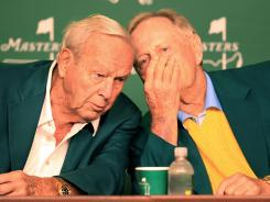 Jack Nicklaus shares a thought with Arnold Palmer listens during a news conference following the honorary tee shots.