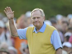 Jack Nicklaus acknowledges the cheers after his ceremonial tee shot.