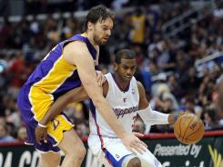 Lakers big man Pau Gasol, left, defends the Clippers' Chris Paul in Wednesday's 113-108 win.