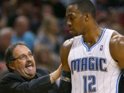Magic coach Stan Van Gundy talks to Dwight Howard during a Feb. 19 game against the Heat.