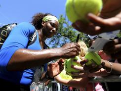 Serena Williams signs autographs after defeating Marina Erakovic of New Zealand on Thursday at the Family Circle Cup in Charleston, S.C.
