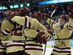 Boston College Eagles forward Paul Carey (22) reacts as he is congratulated by teammates after he scored a goal in the second period against the Minnesota Gophers during the semifinals of the 2012 Frozen Four at Tampa Bay Times Forum. Boston College will face Ferris State in the title game.