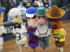 The Racing Sausages take off at Miller Park during a Brewers' game.