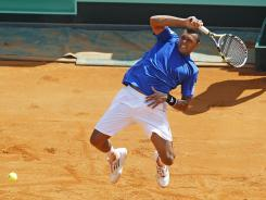Jo-Wilfried Tsonga follows through on a forehand during his four-set victory Friday against the USA's Ryan Harrison in the opening match of the Davis Cup quarterfinal.