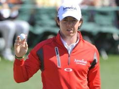 Rory McIlroy acknowledges the cheers on the 18th green after his second-round 69 Friday at the Masters leaving him one shot out of the lead.