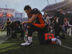 Tim Tebow prays before a game against the Kansas City Chiefs.