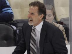 New York Rangers coach John Tortorella yells at the Penguins' bench after a collision between Rangers' Derek Stepan and Penguins' Brooks Orpik Thursday.