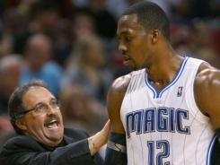 Magic coach Stan Van Gundy talks to Dwight Howard during the third quarter of a game in Miami in February. It's been a contentious season for the two, as Van Gundy confirmed Wednesday that Howard asked for him to be fired.