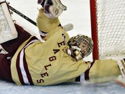 Boston College goalie Parker Milner makes a save against Ferris State during the first period of the NCAA Frozen Four college hockey tournament final on Saturday in Tampa.