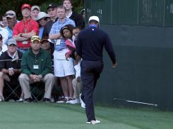 Tiger Woods kicks his club after an errant tee shot on No. 16 on Friday.