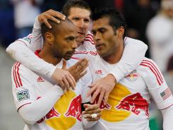 From left: the New York Red Bulls' Thierry Henry, Kenny Cooper, and Wilman Conde celebrate a goal.