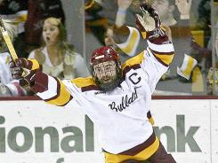 Minnesota-Duluth's Jack Connolly, here celebrating after scoring a goal against North Dakota, was awarded the Hobey Baker as the nation's top college hockey player.