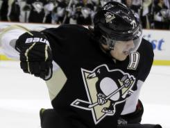 Pittsburgh's Evgeni Malkin celebrates his 50th goal of the season in the second period of the Penguins' win over the Philadelphia Flyers on Saturday night.