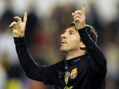 Lionel Messi celebrates after scoring against Zaragoza during Barcelona's 4-1 win Saturday.