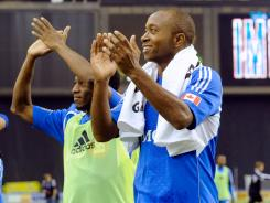 Sanna Nyassi #11 and Collen Warner #18 of the Montreal Impact celebrate after defeating Toronto FC for the franchise's first-ever victory.