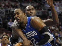 Orlando center Dwight Howard had 20 points and 22 rebounds in the Magic's 88-82 win over the 76ers on Saturday at Philadelphia.