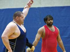 Rulon Gardner beat India's Dharmender Dalal in their 120-kilogram match at the Kiki Cup wrestling competition Jan. 28 at the Olympic Training Center in Colorado Springs, Colo. The match was Gardner's first competition since the Athens Olympics.