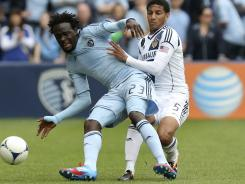 Sporting Kansas City's Kei Kamara, left, fends of the L.A. Galaxy's Sean Frankling during the first half at Livestrong Sporting Park in Kansas City, Kan.