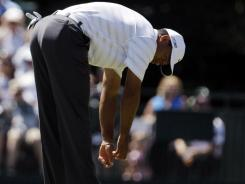 Tiger Woods reacts after missing a birdie putt on the 15th green during the third round of the Masters.
