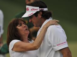 A teary Bubba Watson hugs his mother, Molly, on the green after winning the Masters.