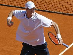 John Isner celebrates after defeating Jo-Wilfried Tsonga to carry the USA past France in a Davis Cup quarterfinal matchup.