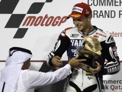 Yamaha Factory Racing's Jorge Lorenzo of Spain celebrates at the Losail International Circuit.