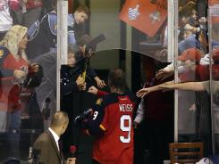 Florida's Stephen Weiss greets fans after the Panthers clinched the Southeast Division title.